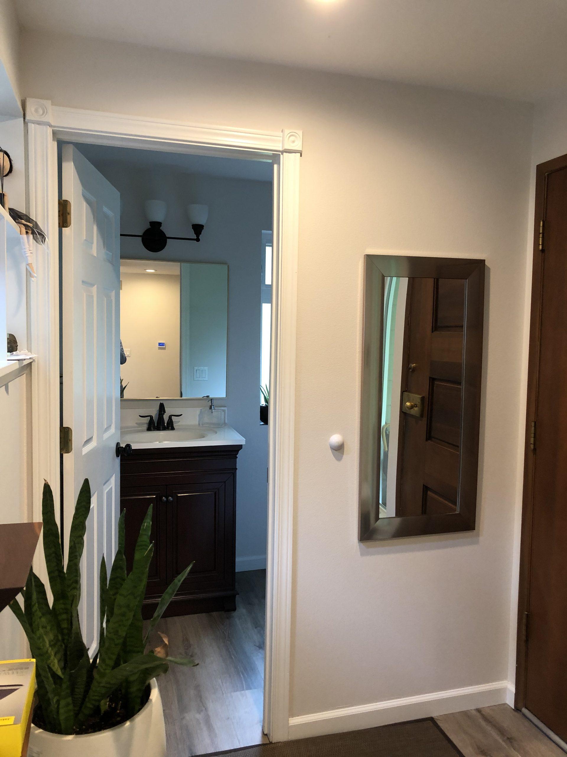 Powder room: half-bath water closet before shot from hallway